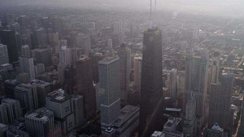 5K stock footage aerial video of John Hancock Center in Downtown Chicago, on a hazy day, Illinois Aerial Stock Footage | AX0001_131
