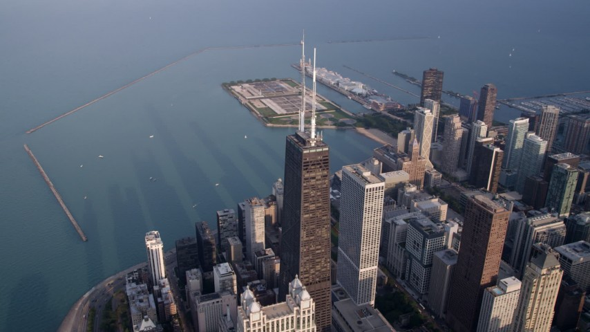 5K stock footage aerial video of John Hancock Center near Lake Michigan, Downtown Chicago, Illinois Aerial Stock Footage AX0001_133