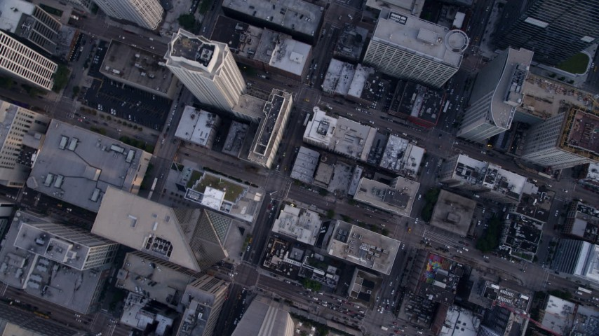 5K stock footage aerial video of a bird's eye view of buildings in downtown, following N State Street, Downtown Chicago, Illinois Aerial Stock Footage | AX0001_136