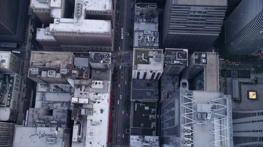 5K stock footage aerial video of Bird's eye view of following N State Street through downtown past skyscrapers, Downtown Chicago, Illinois Aerial Stock Footage | AX0001_139