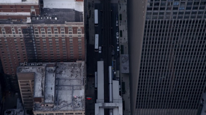 5K aerial  video of a Bird's eye view of L trains in and out of stations in Downtown Chicago, Illinois Aerial Stock Footage | AX0001_147