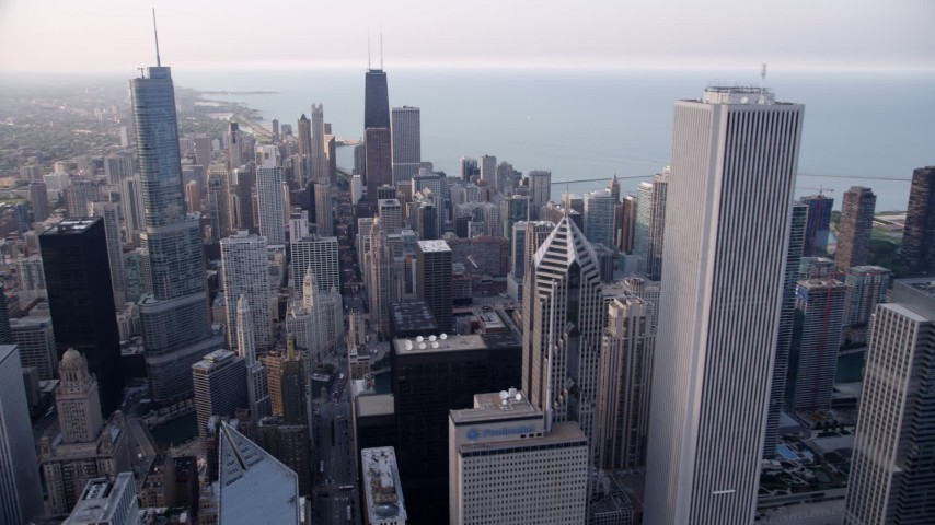 5K stock footage aerial video panning across Downtown Chicago revealing part of Grant Park and boats in the harbor, Illinois Aerial Stock Footage | AX0001_149
