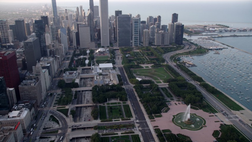 5K stock footage aerial video tilt from the Buckingham Fountain in Grant Park to reveal skyscrapers, Downtown Chicago, Illinois Aerial Stock Footage | AX0001_151