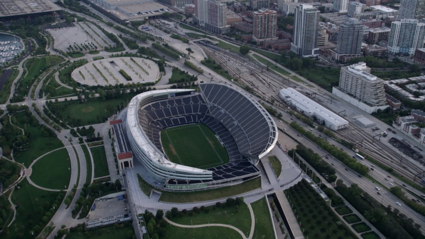 5K stock footage aerial video approach and tilt down to Soldier Field football stadium, Chicago, Illinois Aerial Stock Footage | AX0001_152