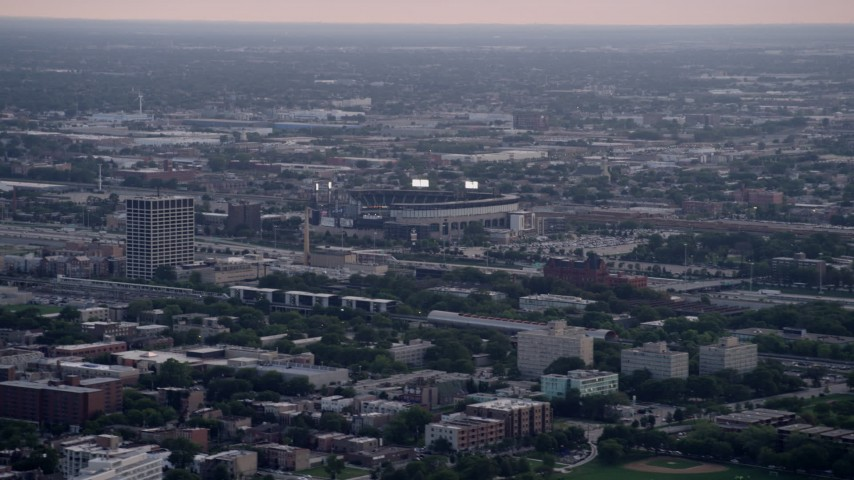 5K stock footage aerial video of White Sox Stadium surrounded by the city scape on a hazy day, Chicago, Illinois Aerial Stock Footage | AX0001_155