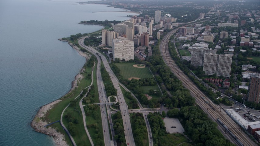 5K stock footage aerial video tilt from Highway 41 and reveal Hyde Park apartment buildings, on a hazy day, Chicago, Illinois Aerial Stock Footage | AX0001_157