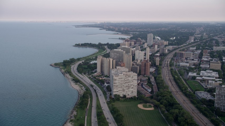 5K stock footage aerial video following Highway 41 toward apartment buildings in Hyde Park, Chicago, Illinois Aerial Stock Footage | AX0001_158