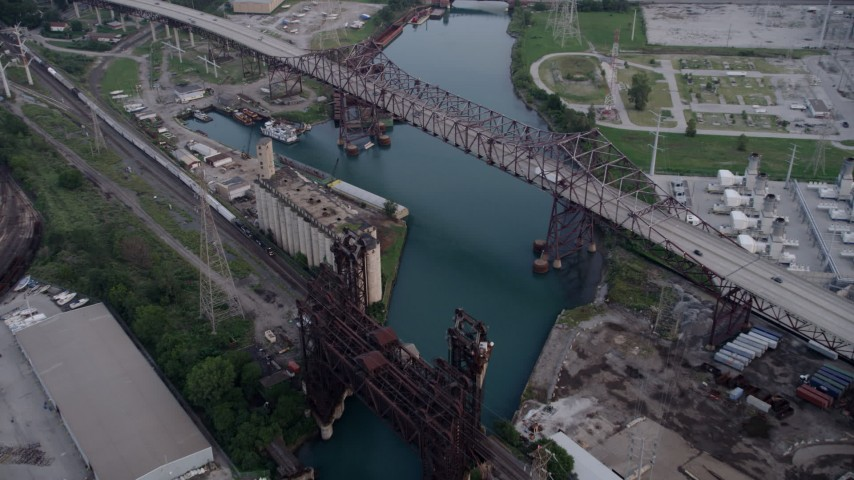 5K aerial video approach grain elevator between High Bridge and Chicago Skyway spanning Calumet River, East Side Chicago, Illinois Aerial Stock Footage | AX0001_165