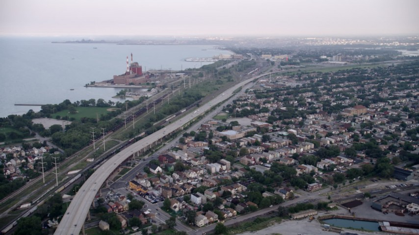5K aerial video of bird's eye of grain elevation, tilt up to Chicago Skyway and freeway, East Side Chicago, Illinois Aerial Stock Footage | AX0001_166