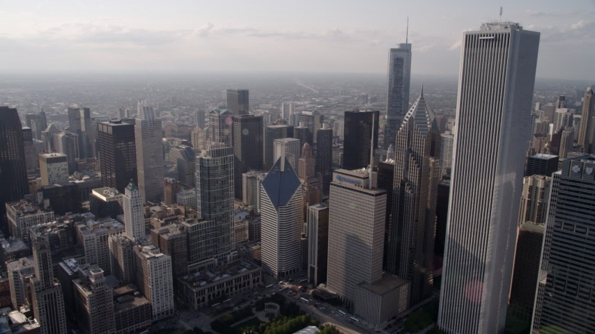 5K aerial stock footage video tilt from Lake Shore Drive, revealing Cloud Gate, Jay Pritzker Pavilion, and downtown Chicago skyscrapers, Illinois Aerial Stock Footage | AX0002_007