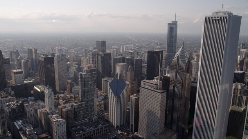 5K stock footage aerial video flying by Aon Center toward skyscrapers around Chicago River, Downtown Chicago, Illinois Aerial Stock Footage | AX0002_008