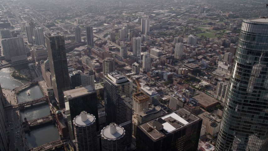5K stock footage aerial video flying over the Chicago River and skyscrapers by Trump International Hotel and Tower, Downtown Chicago, Illinois Aerial Stock Footage | AX0002_010