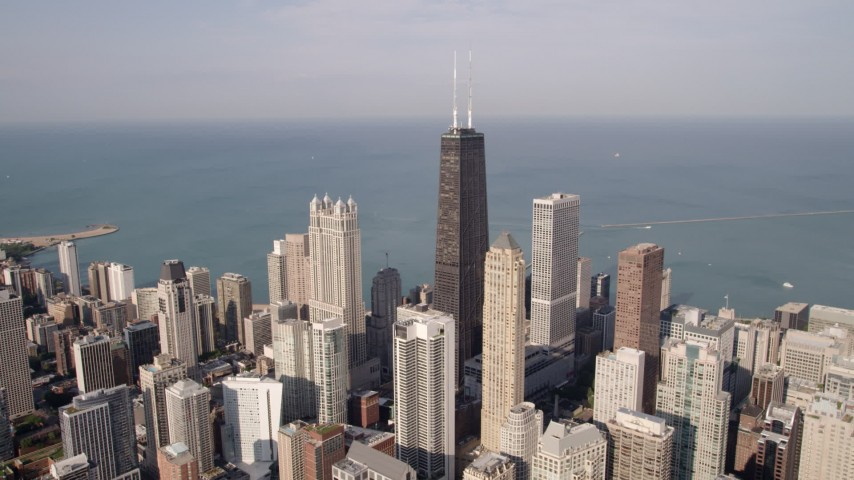 5K aerial  video John Hancock Center near Lake Michigan, Downtown Chicago, Illinois Aerial Stock Footage | AX0002_012