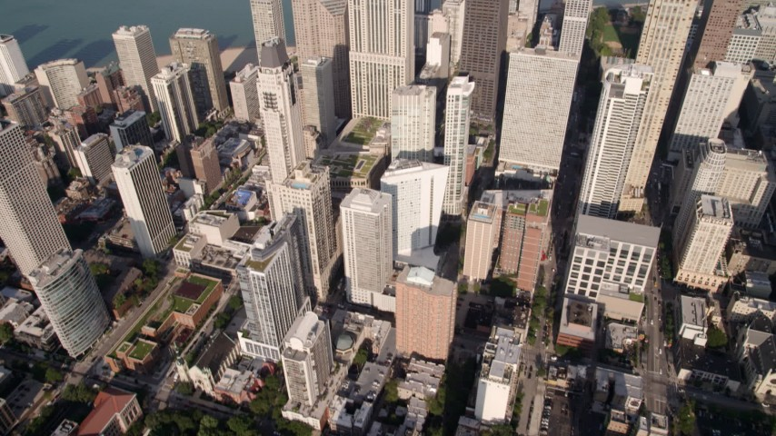 5K stock footage aerial video tilt to reveal John Hancock Center and Lake Michigan, Downtown Chicago, Illinois Aerial Stock Footage | AX0002_013