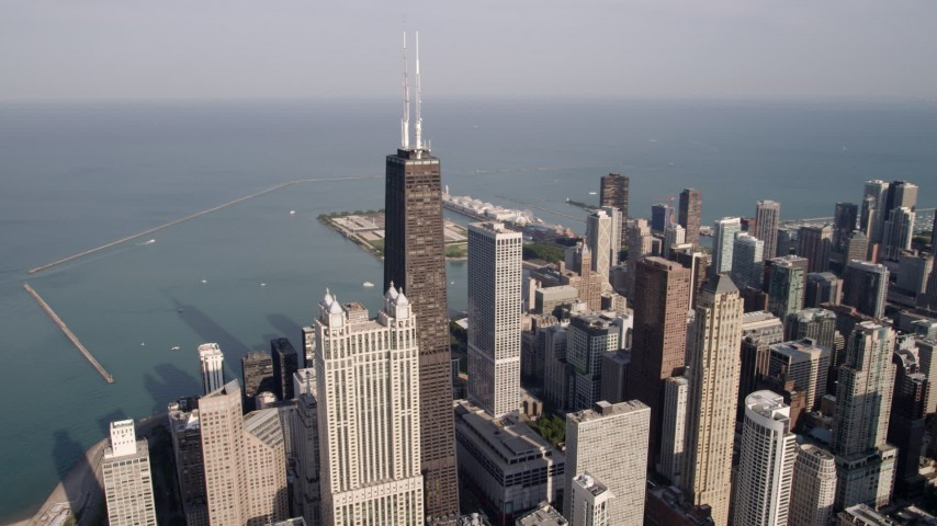 5K aerial video orbiting John Hancock Center with Lake Michigan in the background, Downtown Chicago, Illinois Aerial Stock Footage | AX0002_014