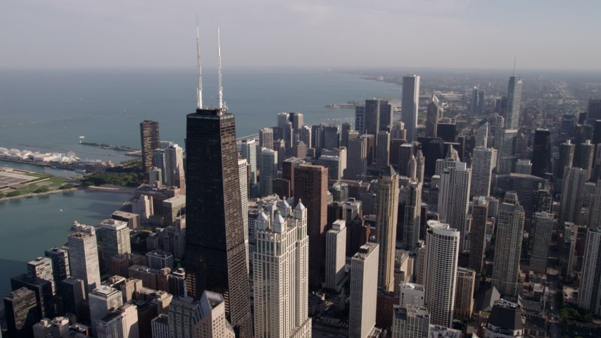 5K stock footage aerial video an orbit of John Hancock Center, with the Downtown Chicago cityscape in the background, Illinois Aerial Stock Footage | AX0002_015