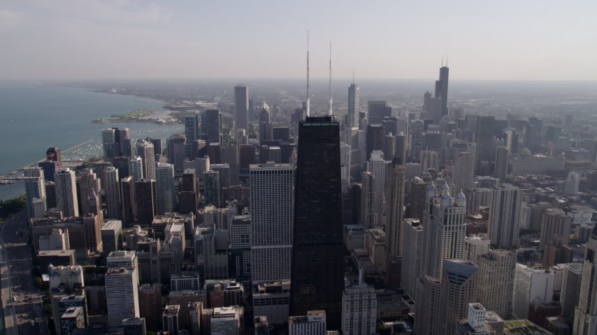 5K aerial video John Hancock Center and downtown skyscrapers, on a hazy day, Downtown Chicago, Illinois Aerial Stock Footage | AX0002_016