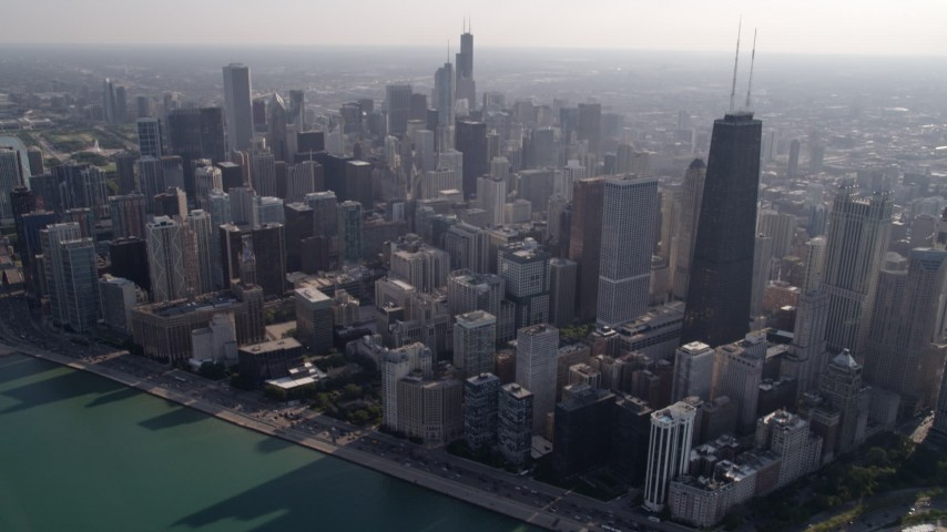 5K stock footage aerial video tilt from Lake Shore Drive to John Hancock Center and skyscrapers in Downtown Chicago, Illinois Aerial Stock Footage | AX0002_017