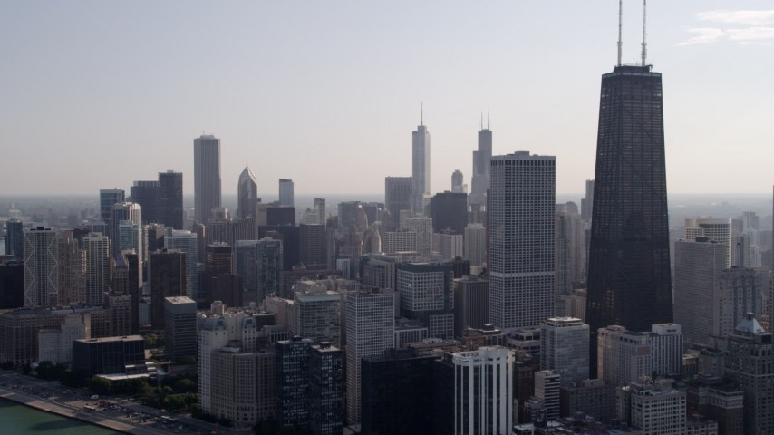 Approach John Hancock Center and downtown from Lake Michigan, Downtown Chicago, Illinois Aerial Stock Footage | AX0002_023