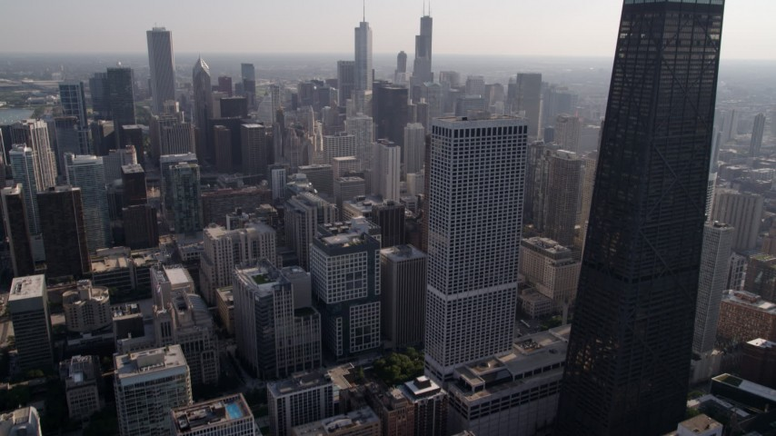 Fly over Lake Shore Drive and tilt up to approach Downtown Chicago, Illinois Aerial Stock Footage | AX0002_024
