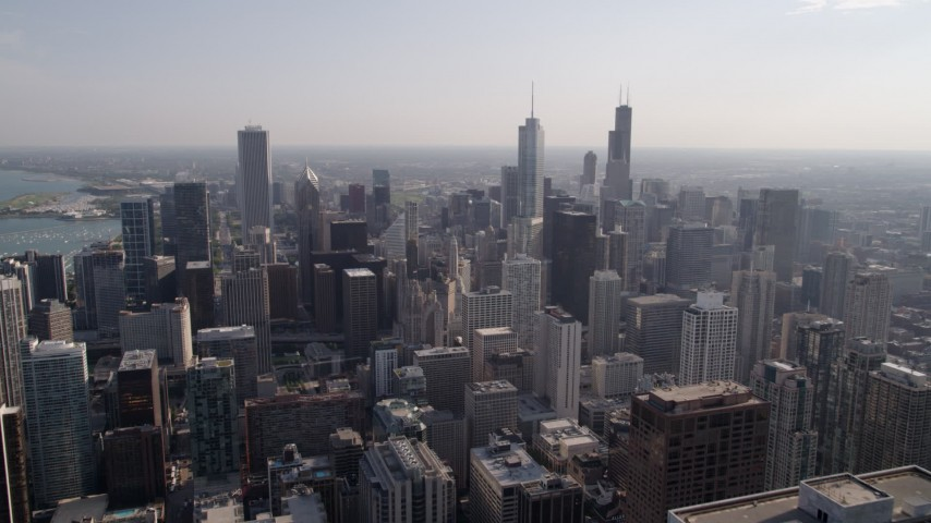 5K stock footage aerial video of flying over Downtown Chicago toward Trump Tower Chicago on a hazy day, Illinois Aerial Stock Footage | AX0002_025
