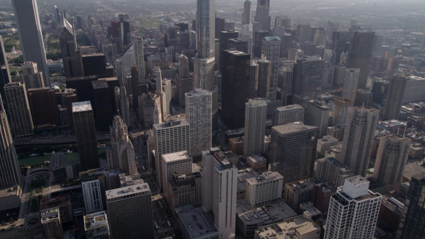 5K stock footage aerial video tilt to N Michigan Avenue and reveal Tribune Tower and Chicago River, Downtown Chicago, Illinois Aerial Stock Footage | AX0002_026