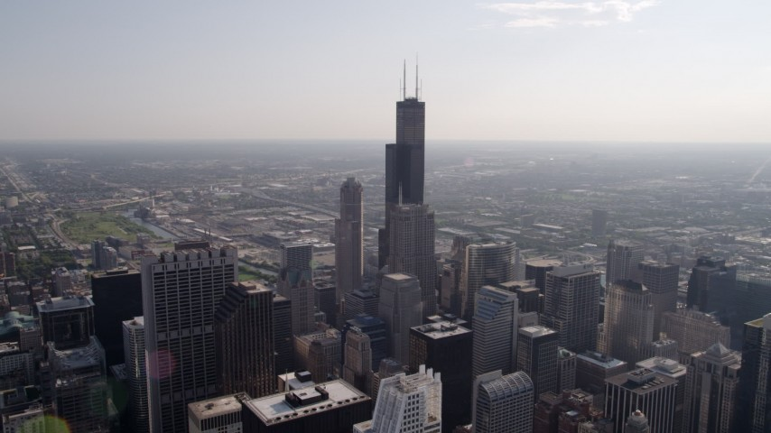 Flying over Downtown Chicago toward Willis Center, Illinois Aerial Stock Footage | AX0002_028