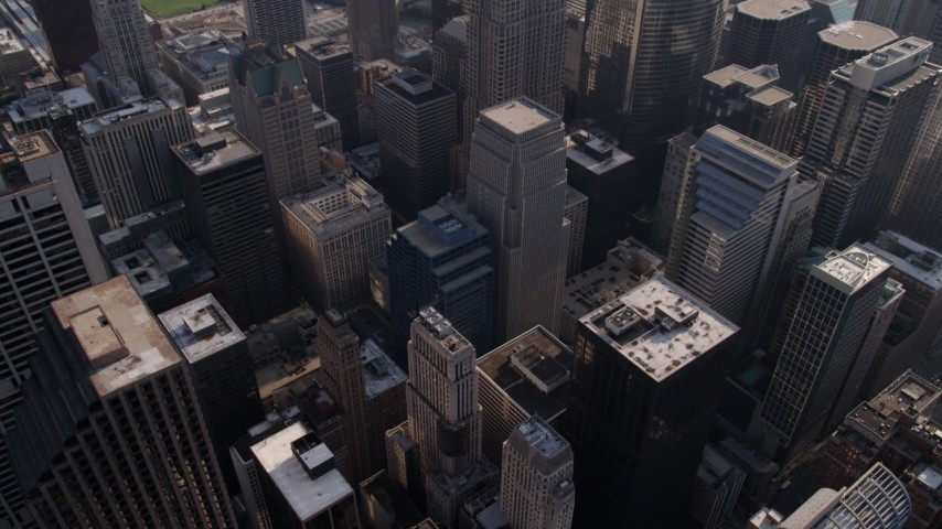 Approach Willis Center, and tilt down to Downtown Chicago skyscrapers, Illinois Aerial Stock Footage | AX0002_029
