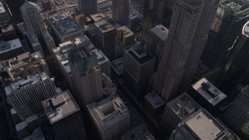 Tilt from a bird's eye view of skyscrapers to reveal 311 South Wacker Drive and Willis Tower, Downtown Chicago, Illinois Aerial Stock Footage | AX0002_030
