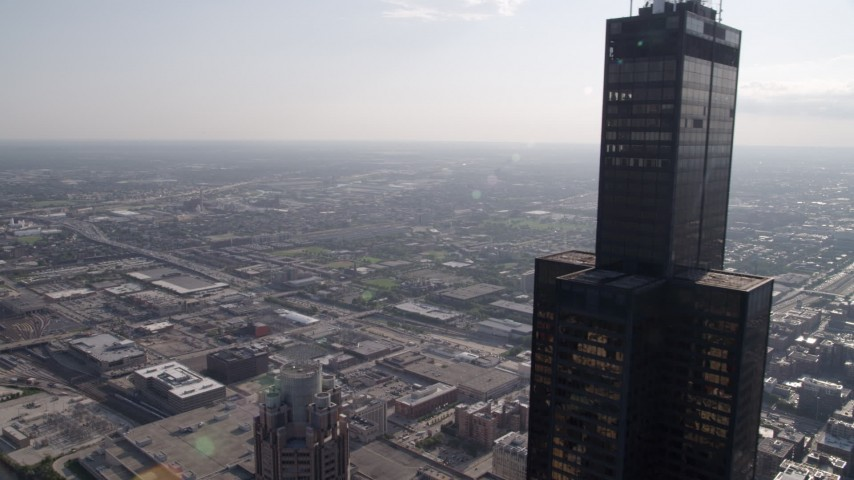 5K stock footage aerial video of flying by Willis Tower toward West Chicago, on a hazy day, Illinois Aerial Stock Footage | AX0002_031