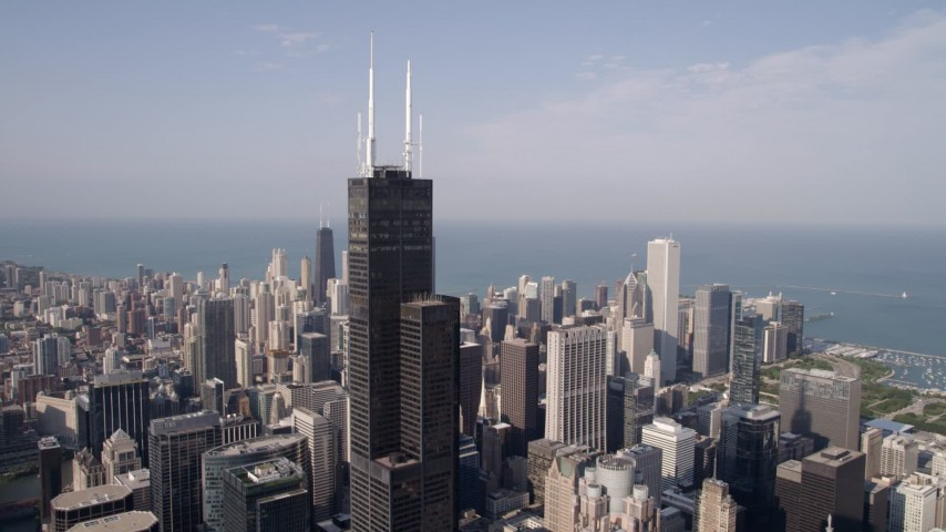 Flying away from Willis Tower in Downtown Chicago, Illinois Aerial Stock Footage | AX0002_032