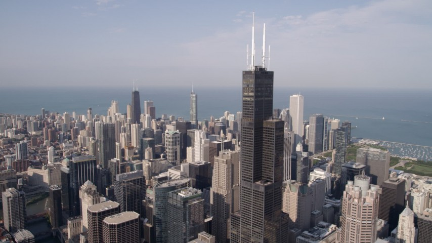 5K stock footage aerial video flyby Willis Tower and downtown skyscrapers in Downtown Chicago, Illinois Aerial Stock Footage AX0002_033 | Axiom Images