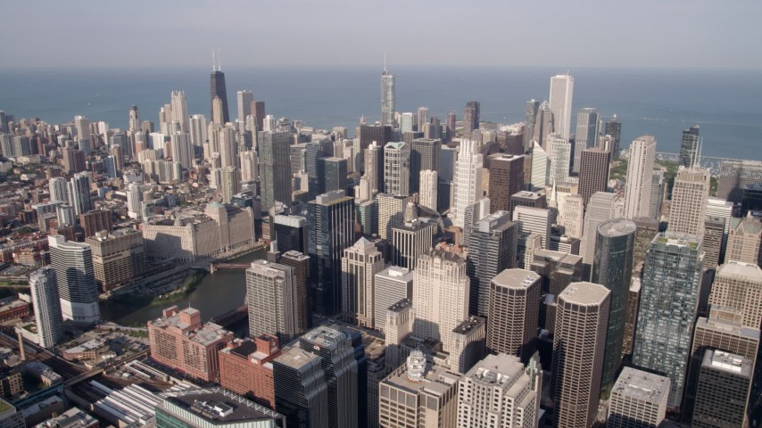 5K stock footage aerial video of Downtown Chicago skyscrapers seen from Willis Tower, reveal the Chicago River, Illinois Aerial Stock Footage | AX0002_034