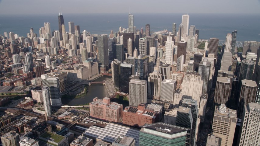 Flyby downtown skyscrapers and the Chicago River in Downtown Chicago, Illinois Aerial Stock Footage | AX0002_035