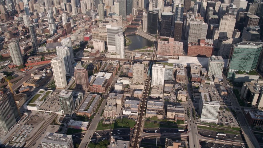 Tilt from freeway in West Chicago to reveal Downtown Chicago and the Chicago River, Illinois Aerial Stock Footage | AX0002_036