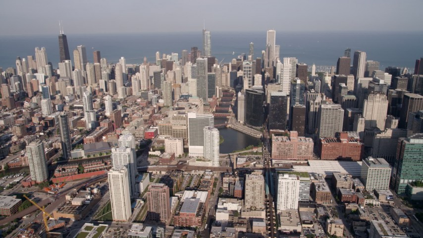 Chicago River and surrounding skyscrapers and high-rises, Downtown Chicago, Illinois Aerial Stock Footage | AX0002_037