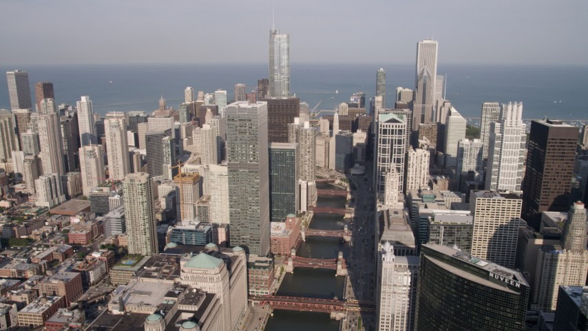5K stock footage aerial video of following the Chicago River through Downtown Chicago, Illinois Aerial Stock Footage | AX0002_039