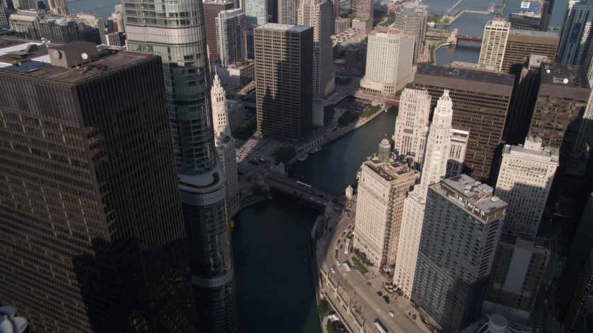 Following the Chicago River past 321 North Clark and Marina City in Downtown Chicago, Illinois Aerial Stock Footage | AX0002_040