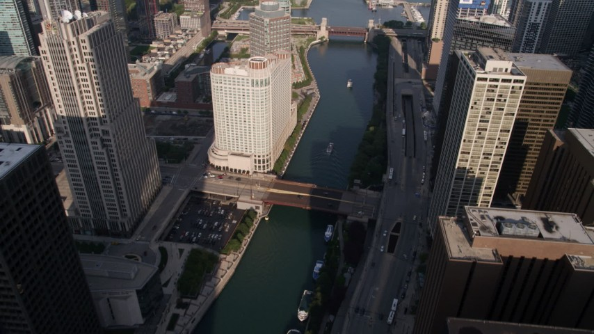 Following the Chicago River with bridges in Downtown Chicago, Illinois Aerial Stock Footage | AX0002_041