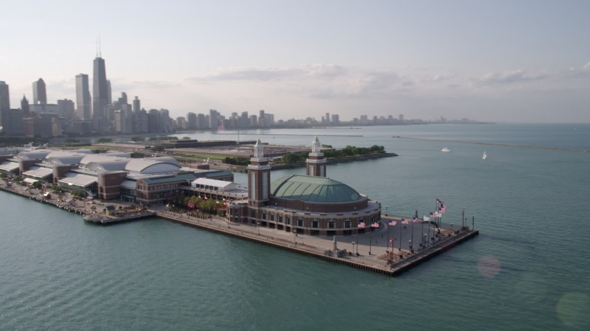 Orbiting the end of Navy Pier, revealing the Downtown Chicago skyline, Illinois Aerial Stock Footage | AX0002_045