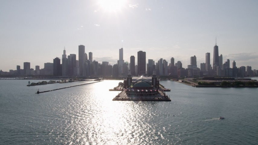 A reverse view of Navy Pier and the Downtown Chicago skyline seen from Lake Michigan, Illinois Aerial Stock Footage | AX0002_046