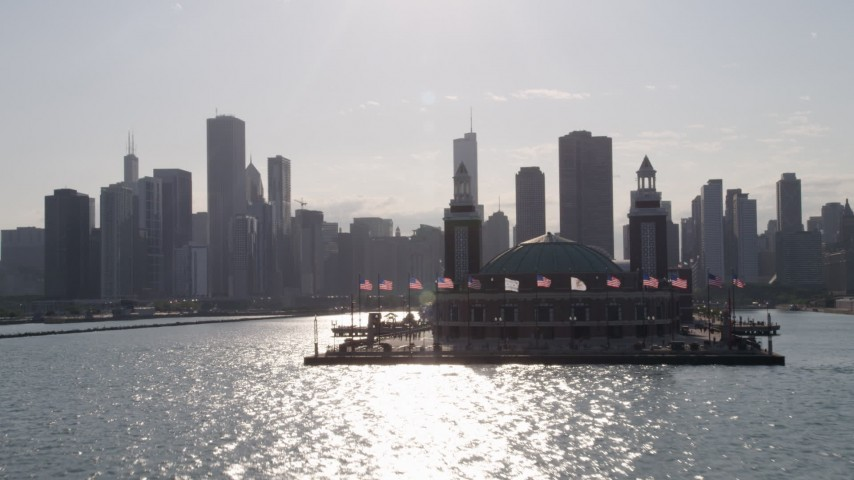 Tilt from Lake Michigan to reveal and approach Navy Pier and Downtown Chicago, Illinois Aerial Stock Footage | AX0002_049