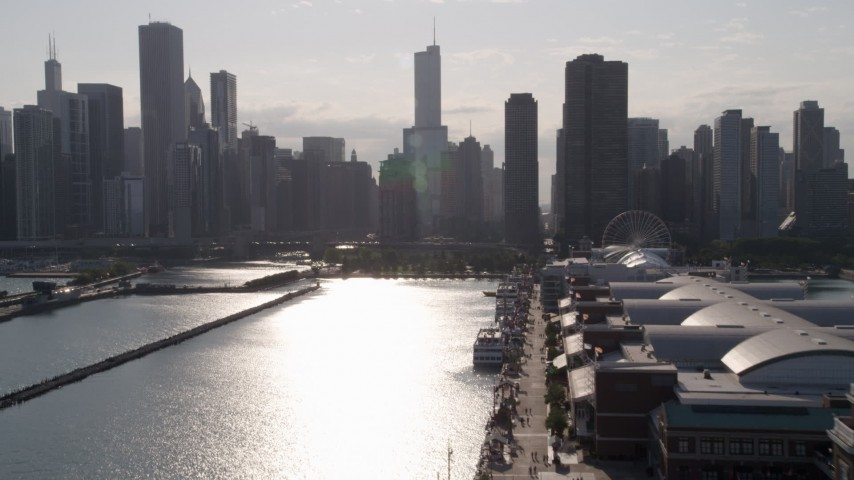 Flying over Navy Pier toward Chicago River and Downtown Chicago, Illinois Aerial Stock Footage | AX0002_050