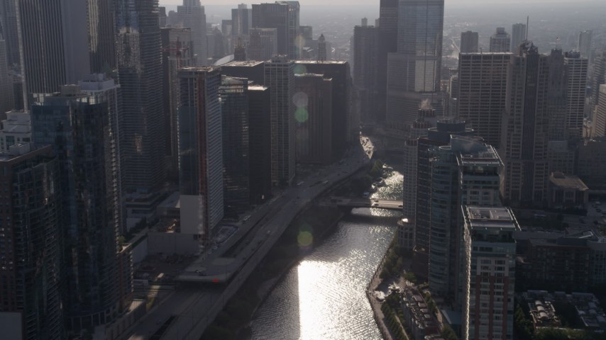 Fly over bridge at the mouth of the Chicago River, Downtown Chicago, Illinois Aerial Stock Footage | AX0002_052
