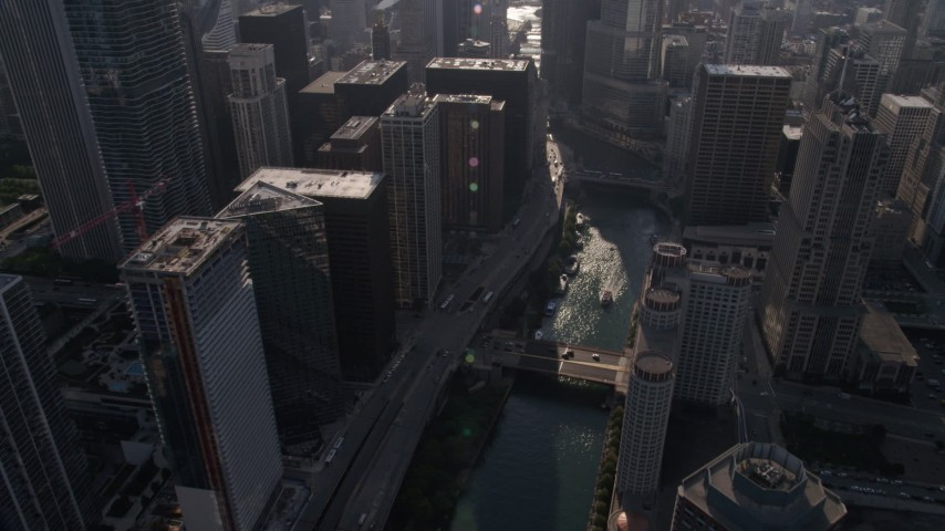 Following the Chicago River through Downtown Chicago, Illinois Aerial Stock Footage | AX0002_053