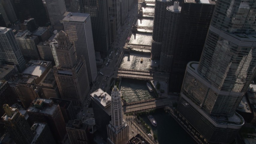 5K stock footage aerial video of bird's eye view of bridges spanning Chicago River, revealing Tribune Tower and Marina City, Downtown Chicago, Illinois Aerial Stock Footage | AX0002_054
