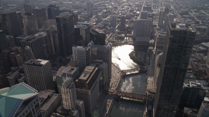 Bird's eye of the Chicago River through downtown, and bridges spanning the river, Downtown Chicago, Illinois Aerial Stock Footage | AX0002_055