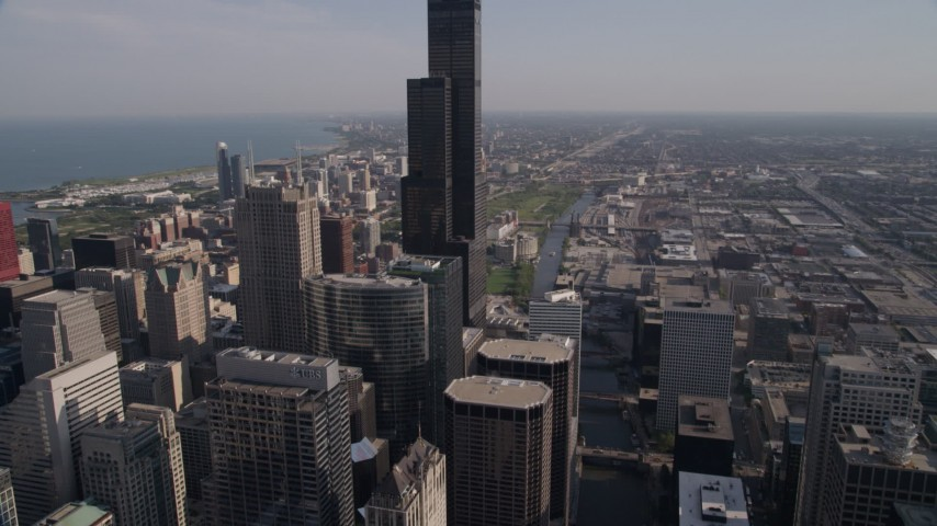 Tilt from Chicago River to approach Willis Tower, Downtown Chicago, Illinois Aerial Stock Footage | AX0002_057