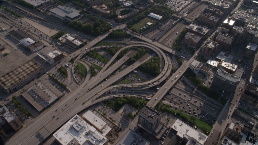 Tilt to bird's eye view of the Circle Interchange in West Chicago, Illinois Aerial Stock Footage | AX0002_058
