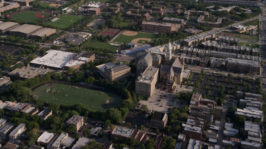 5K stock footage aerial video of orbiting a football field at St. Ignatius College Prep in West Side Chicago, Illinois Aerial Stock Footage | AX0002_060